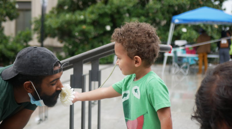 A father and son stop and smell the flowers #FreeCapitolHillTN - 06/30/20